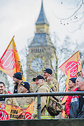 Some wear Pinnochio noses to highlight the feeling tha tthey have been lied to. The Fire Brigades Union holds a protest rally and marc.  Stating at Methodist Central Hall and then heading for Parliament. They are demanding a farer pension settlement and a rethink of the increased retirement age. They accuse Penny Mordaunt, the minister responsible, of lieing to them about the changes and their impact. Westminster London, UK 25 Feb 2015.