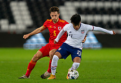 SWANSEA, WALES - Thursday, November 12, 2020: Wales' Tom Lockyer (L) and USA's Ulysses Llanez during an International Friendly match between Wales and the USA at the Liberty Stadium. (Pic by David Rawcliffe/Propaganda)