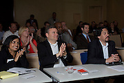 Audience members listen as HISD's Sue Robertson, Leo Bobadilla and Robert Sands present at the 2013 Council of Educational Facility Planners International Southern Region Conference about planning and passing a $1.89 billion bond referendum.<br /> Photo by Christina Burke