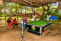Dassanach tribe men playing pool, Omo Valley,  Southern Nations Nationalities and People's Region, Ethiopia.