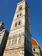 The tower from the Basilica di Santa Maria del Fiore, a building more commonly known as the 'Duomo'. Florence, Italy. Started in 1296 based on Arnolfo di Cambio's design, but was not complete until 1436 when Filippo Brunelleschi engineered the dome. One of Italy's largest churches.