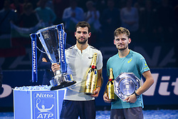 November 19, 2017 - London, England, United Kingdom - Winner, Grigor Dimitrov of Bulgaria and runner up David Goffin of Belgium hold their trophies following the singles final during day eight of the 2017 Nitto ATP World Tour Finals at O2 Arena on November 19, 2017 in London, England. (Credit Image: © Alberto Pezzali/NurPhoto via ZUMA Press)