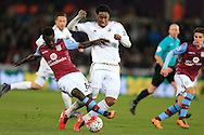 Leroy Fer of Swansea city is tackled by Idrissa Gana Gueye of Aston Villa.  Barclays Premier league match, Swansea city v Aston Villa at the Liberty Stadium in Swansea, South Wales on Saturday 19th March 2016.<br /> pic by  Andrew Orchard, Andrew Orchard sports photography.