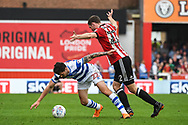 Brentford Defender Henrik Dalsgaard (22) and Queens Park Rangers Midfielder Pawel Wszolek (22) battle for the ball during the EFL Sky Bet Championship match between Brentford and Queens Park Rangers at Griffin Park, London, England on 21 April 2018. Picture by Stephen Wright.
