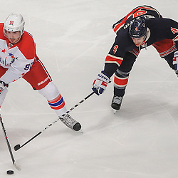 Washington Capitals center Marcus Johansson (90) makes a pass away from New York Rangers defenseman Michael Del Zotto (4) during first period NHL action between the Washington Capitals and the New York Rangers at Madison Square Garden in New York, N.Y.