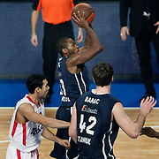 Anadolu Efes's Oliver Lafayette (C) during their Turkish Airlines Euroleague Basketball Top 16 Group E Game 4 match Anadolu Efes between Olympiacos at Sinan Erdem Arena in Istanbul, Turkey, Wednesday, February 08, 2012. Photo by TURKPIX