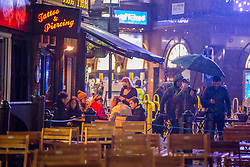 © Licensed to London News Pictures. 24/10/2020. London, UK. Despite the rainy weather and Tier 2 lockdown, revellers hit the streets of Soho in central London. Photo credit: Marcin Nowak/LNP