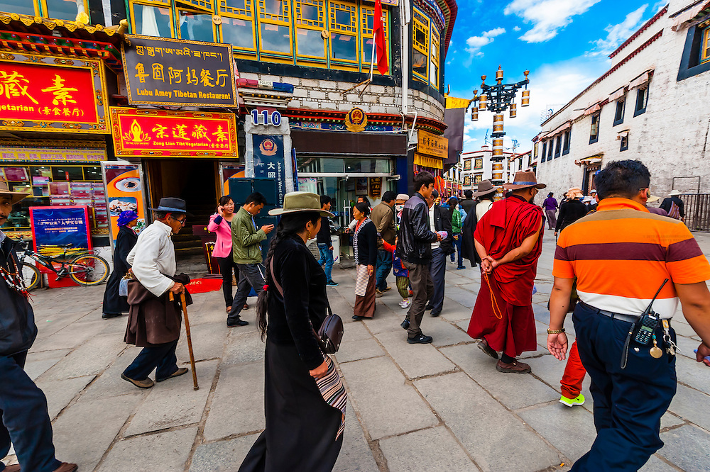 """Tibetan pilgrims circumambulate the route called """"The Barkhor"""" around the Jokhang Temple, which is the most sacred in Tibet. Lhasa, Tibet, China."""