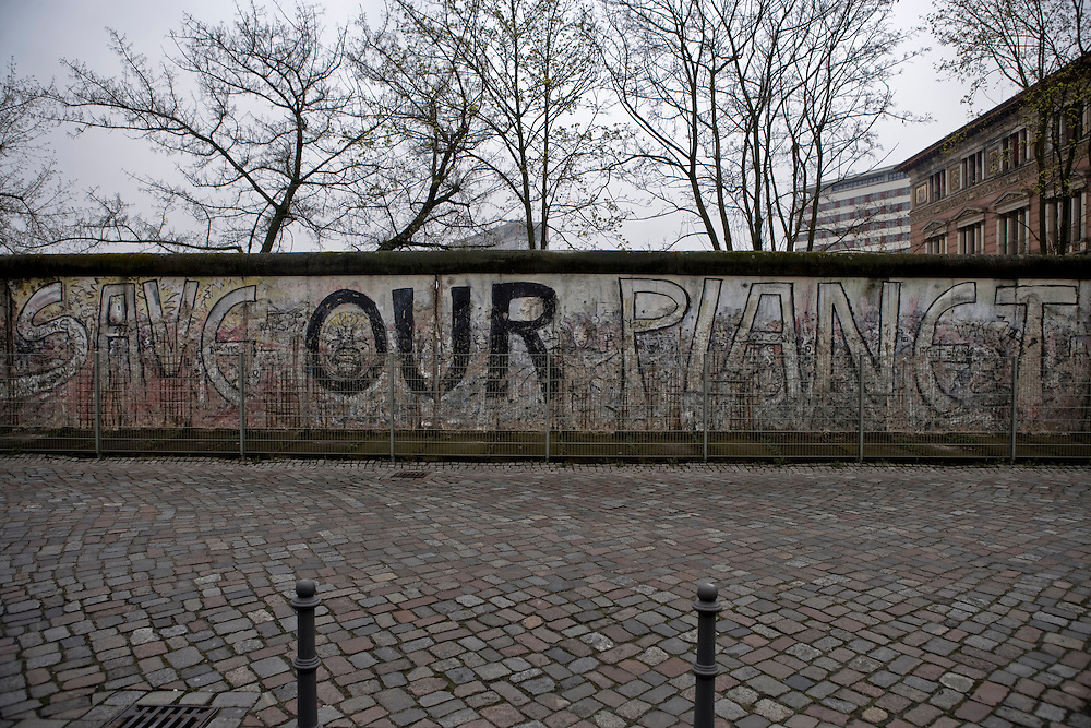 The last remaining section of the Berlin Wall still standing with Graffiti