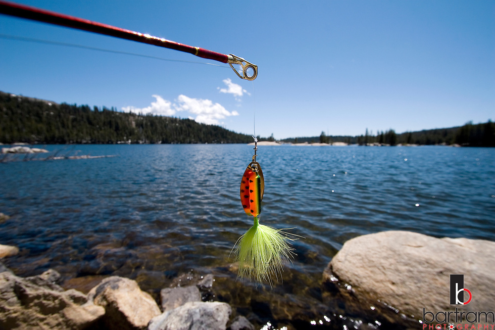 A fishing lure hangs from the end of a rod at Lake Alpine near California State Highway 4 in the Sierra Nevada Mountains on Saturday, June 7, 2008. The lake is at 7,350 feet elevation in the Stanislaus National Forest. (Photo by Kevin Bartram)