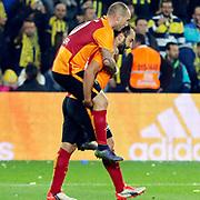 Galatasaray's Wesley Sneijder (L) and Olcan Adin (R) during their Turkish super league soccer derby Fenerbahce between Galatasaray at the Sukru Saracaoglu stadium in Istanbul Turkey on Sunday 25 October 2015. Photo by Kurtulus YILMAZ/TURKPIX