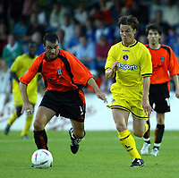 Photo. Chris Ratcliffe<br />Colchester United v Charlton Athletic. Pre Season Friendly. 22/07/2003<br />Matt Holland goes for the ball aganst a Colchester player