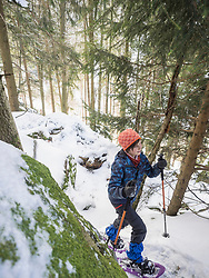 High angle view of a Girl snowshoeing in Black Forest, Germany, Europe