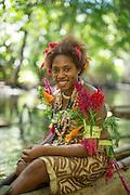 Girl on canoe in the mangroves, Mclaren Harbour, Tufi, Cape Nelson, Oro Province, Papua New Guinea
