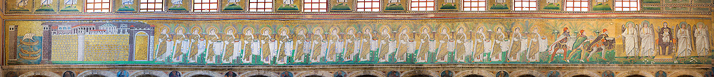Byzantine Roman mosaics , c. 561 AD, in the Basilica of Sant Apollinare Nuovo, depicting 22 Virgins led by the Three Magi, moving from the city of Classe towards the group of the Madonna and Child surrounded by four angels. Ravenna Italy, A UNESCO World Heritage Site.
