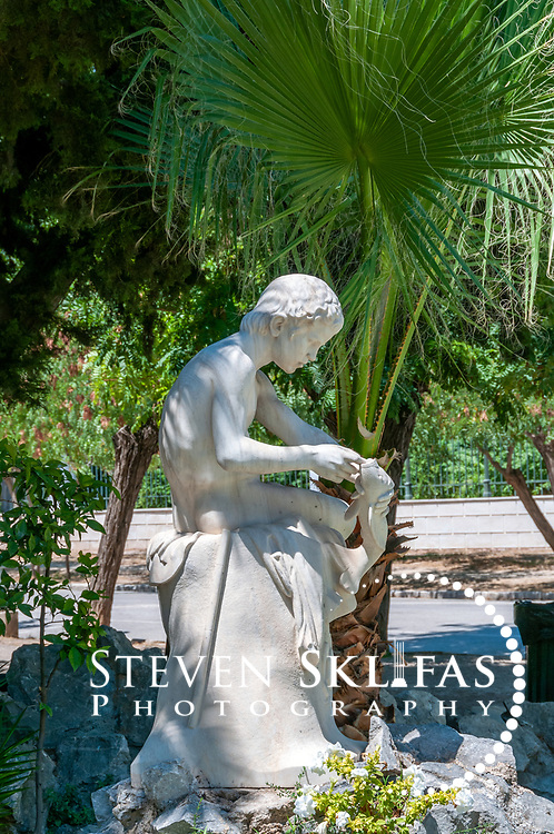 Athens. Greece. View of the 19th century Little Fisherman sculpture by Dimitrios Filippotis at the Zappeion Gardens which is an extension of the adjacent National Gardens, a vast green refuge and oasis in the centre of Athens.