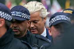 London, UK. 9th June, 2018. Police escort Geert Wilders, founder and leader of the Dutch Party for Freedom, to speak at the far-right March for Tommy Robinson in Parliament Street.