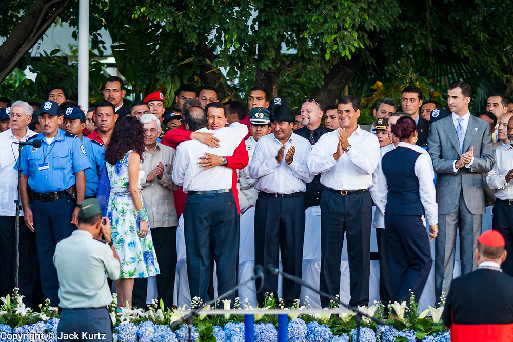 """10 JANUARY 2007 - MANAGUA, NICARAGUA: HUGO CHAVEZ, the President of Venezuela, hugs DANIEL ORTEGA, President of Nicaragua (back to camera) in Managua. Ortega, the leader of the Sandanista Front, was sworn in as the President of Nicaragua Wednesday. Ortega and the Sandanistas ruled Nicaragua from their victory of """"Tacho"""" Somoza in 1979 until their defeat by Violetta Chamorro in the 1990 election. Chavez was a special guest and featured speaker.  Photo by Jack Kurtz"""