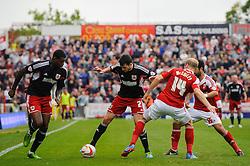 Bristol City Defender Brendan Moloney (IRL) is challenged by Swindon Defender James McEveley (SCO) during the first half of the match - Photo mandatory by-line: Rogan Thomson/JMP - Tel: 07966 386802 - 21/09/2013 - SPORT - FOOTBALL - County Ground, Swindon - Swindon Town v Bristol City - Sky Bet League 1.
