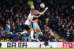 Joe Bryan of Fulham challenges Chris Wood of Burnley - Mandatory by-line: Robbie Stephenson/JMP - 26/08/2018 - FOOTBALL - Craven Cottage - Fulham, England - Fulham v Burnley - Premier League