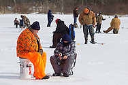 Middletown, New York - People ice fish at the Shawangunk Fish and Game Association pond during the association's annual contest on Feb. 8, 2014. ©Tom Bushey / The Image Works