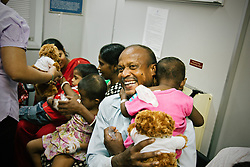 A group of children wait for pediatric ophthalmic services onboard the ORBIS Flying Eye Hospital in Kolkata, India.