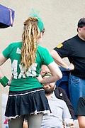 RollerGirl waitress taking orders in beer garden Grand Old Day Street Fair St Paul Minnesota USA