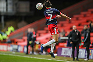 Doncaster Rovers defender Niall Mason (2) heads the ball during the The FA Cup 2nd round match between Charlton Athletic and Doncaster Rovers at The Valley, London, England on 1 December 2018. Photo by Toyin Oshodi