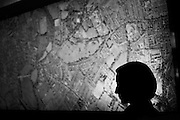 a woman in front a city map