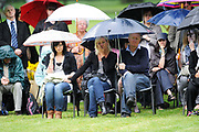People listen to speeches at the memorial to the victims of the July 7th London bombings, at Hyde Park in London. Thursday marks the sixth anniversary of the July 7 bombings, which killed 52 people and injured more than 770 in terrorist attacks.