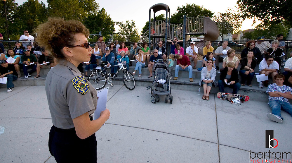 Brentwood Police Department Community Service Officer Michelle Keady listens to residents' concerns during a Neighborhood Watch organizational meeting at Creekside Park on Wednesday, May 7, 2008. About 50 residents attended the meeting. (Kevin Bartram/For The Press)