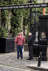Pictured:   Security man Johnathon Bayley checked all those entering the beer garden at the Pear TRee and took their temparatures before they were allowed into the garden.<br /> <br /> Pubs with beer gardens are back in action in Scotland from today.  The Pear Tree and 56 North in Edinburgh asked customers to book socially distanced tables for two-hour slots.  This is to protect staff and customers alike.  All details of booked clients are retained and temperatures taken before anybody is permitted in the Covid 19 free zone. Operations manager for the Pear Tree, Brian Dobie was keen to show customers that the bar was taking their responsibilities seriously with only table service for all food and drink.  Any walk up customers to 56 North have to provide their contact details to ensure any health issues can be traced if required.