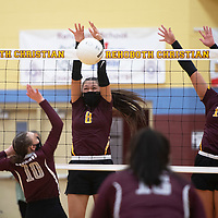 Rehoboth Christian's Emma Egan (8) and Jessica Triplett (13) defend the net with a double block against a spike by Ramah's Chancie Clawson (10) Tuesday in Rehoboth.