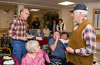Clifford Ireland U.S. Navy (on left) is honored and awarded a plaque of appreciation by David Hayden during a Veteran's Appreciation ceremony at the Belknap County Nursing Home on Tuesday afternoon.  (Karen Bobotas/for the Laconia Daily Sun)