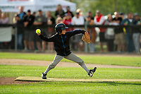 KELOWNA, CANADA - JUNE 28: A young baseball player throws the opening pitch during the opening charity game of the Home Base Slo-Pitch Tournament fundraiser for the Kelowna General Hospital Foundation JoeAnna's House on June 28, 2019 at Elk's Stadium in Kelowna, British Columbia, Canada.  (Photo by Marissa Baecker/Shoot the Breeze)