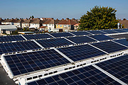 The  25kW solar panel array on the roof of Knowle West Media Centre. Supported by Bristol Energy, a community-owned energy cooperative, growing Greater Bristol's local green energy supply and making the benefits available to all. Bristol, UK.