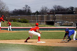 15 February 2007: Mike Hlavacek makes a pickoff throw to Jesse Griswold in an attempt to pick off Ryan Strausberger. Indiana State Sycamores gave up the first game of the double-header by a score of 16-6 to the Illinois State Redbirds at Redbird Field on the campus of Illinois State University in Normal Illinois.