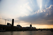 Dramatic sky over the River Thames looking at Millennium Bridge, London, UK.