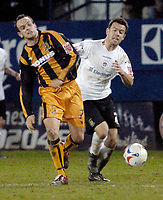 Photo: Leigh Quinnell.<br /> Luton Town v Hull City. Coca Cola Championship. 13/03/2007. Hulls Stuart Elliott battles with Lutons Keith Keane.