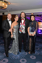 Left to right, TRUDI & PAUL BESWICK and DAVE MYERS and his wife at the Caudwell Children's annual Butterfly Ball held at The Grosvenor House Hotel, Park Lane, London on 15th May 2014.