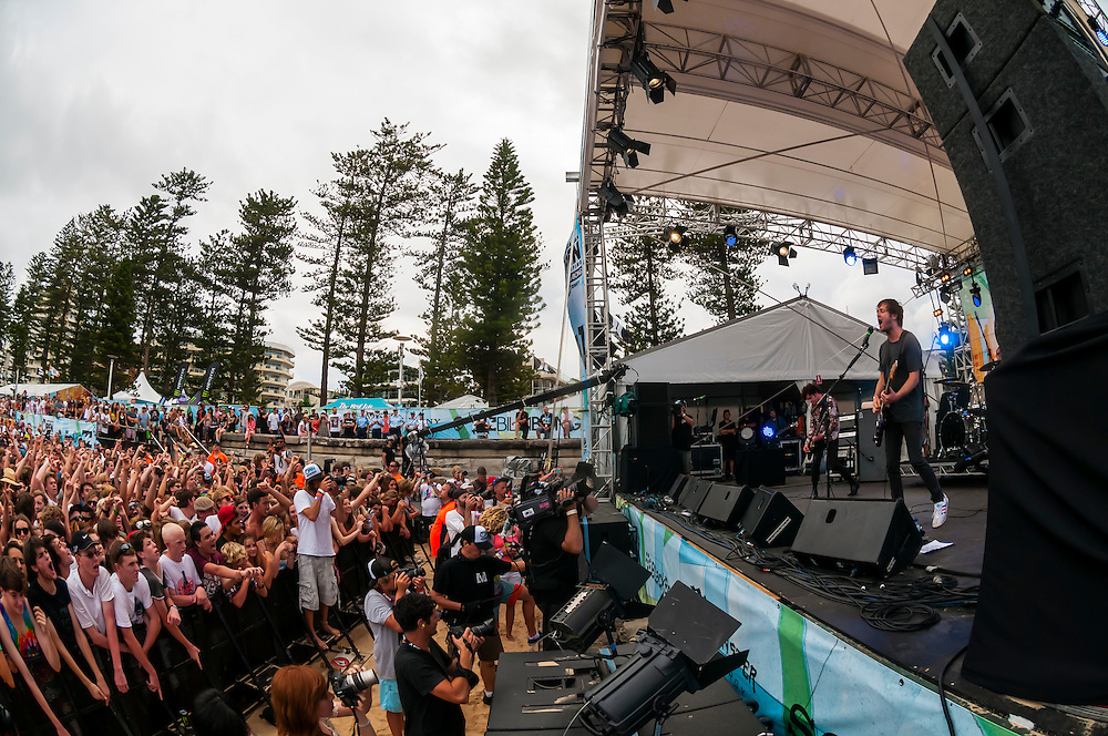 """The rock band """"Children Collide"""" perform at a concert on the beach during the Australian Open of Surfing at Manly Beach, Sydney, New South Wales, Australia."""