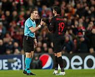 Referee Danny Makkelie has words with Diego Costa of Atletico Madrid during the UEFA Champions League match at Anfield, Liverpool. Picture date: 11th March 2020. Picture credit should read: Darren Staples/Sportimage