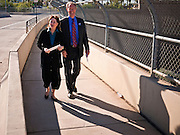 02 NOVEMBER 2010 - PHOENIX, AZ: Terry Goddard (CQ) RIGHT and his wife, Monica Goddard (CQ), walk to their polling place at Kenilworth Elementary School in Phoenix Tuesday morning. The Goddards are on the early voting list but walked up to Kenilworth to drop off their ballots.  Kenilworth is where Terry Goddard votes.   Goddard lost the election to sitting Governor Jan Brewer, a conservative Republican.     PHOTO BY JACK KURTZ