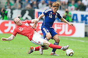 Yoshito Okubo (Japan) & Wayne Rooney (England), , May 30, 2010 - Football : World Cup South Africa 2010 test match ,  match between Japan 1-2 England  at Libenau stadium, Graz, Austria, (Photo by Enrico Calderoni/AFLO SPORT) [0391]