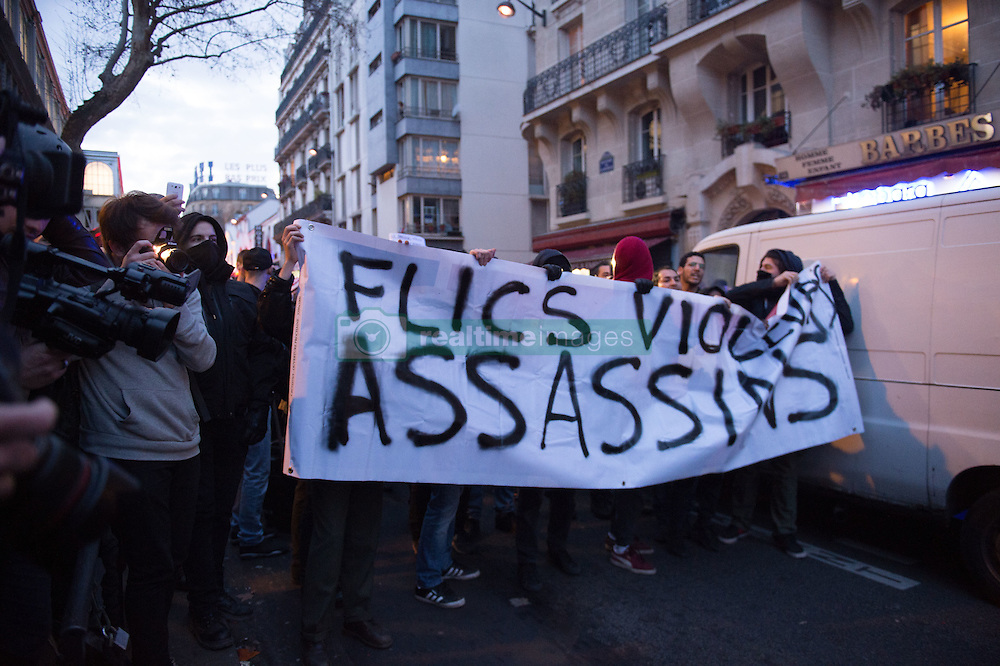 Protesters hold a banner reading 'Cops, rapists, killers' as people gather during a demonstration to show support to a 22-year-old youth worker, identified only as Theo, after he was assaulted on February 2, in Barbes Rochechouart district in Paris, on February 15, 2017. Photo by Eliot Blondet/ABACAPRESS.COM