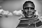 A black and white portrait of aTurkana women wearing the traditional green beaded necklace of a healer or witch doctor, Lake Turkana, Loiyangalani,Kenya, Africa