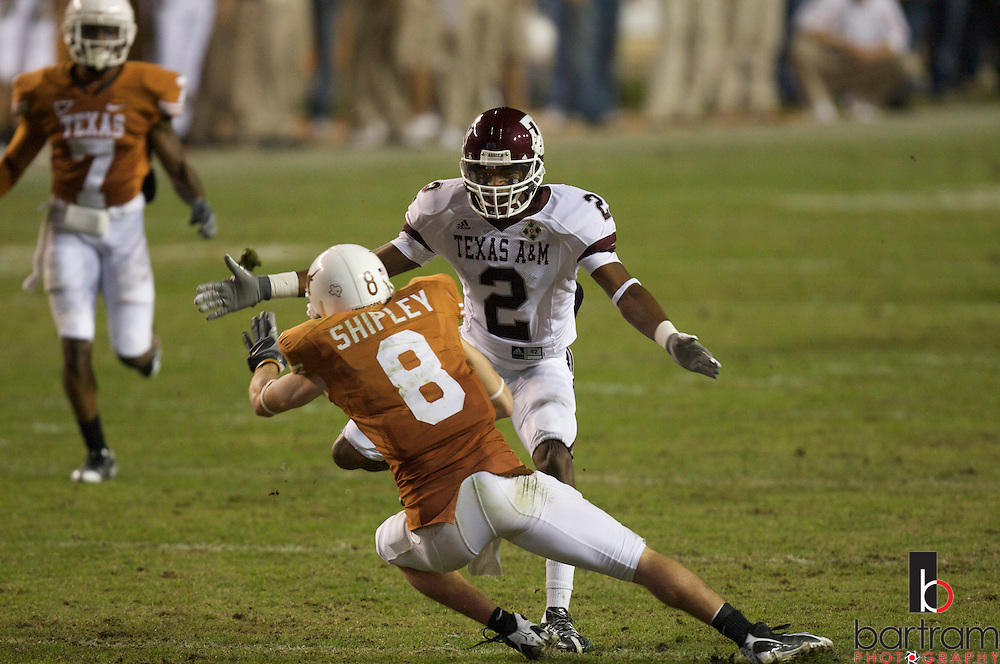 Texas A&M defensive back Marcus Gold closes in on Texas receiver Jordan Shipley at the University of Texas at Darrell K Royal Texas Memorial Stadium in Austin, Texas on Thursday, Nov. 27, 2008. The Univeristy of Texas won the game 49-9.