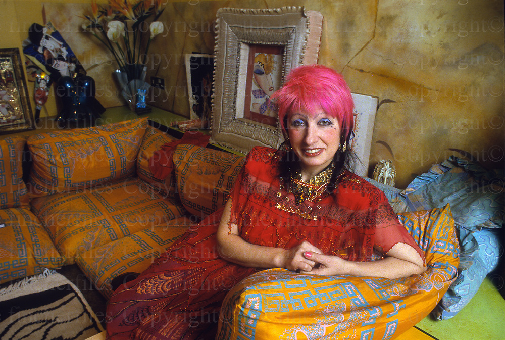 British fashion designer Zandra Rhodes seen at her London home in 1986. Photographed by Jayne Fincher