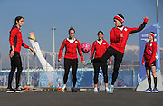 The Swiss women's ice hockey team warms up outside Shayba Arena near the Olympic torch before their game against Canada at the Winter Olympics in Sochi, Russia, Saturday, February 8, 2014. (Brian Cassella/Chicago Tribune/MCT)
