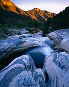 Sabino Creek flowing through fluted gneiss, Santa Catalina Mountains northeast of Tucson, Coronado National Forest, Arizona.